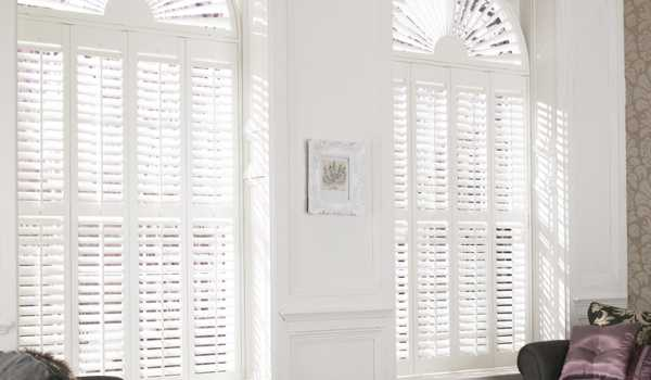 arched windows white shutters
