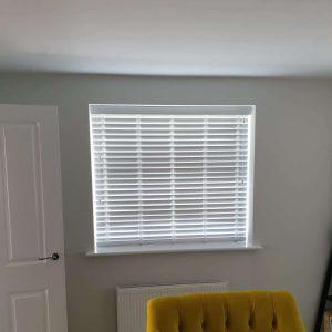 white Venetian blinds in modern room