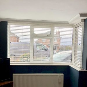 white Venetian blinds with navy blue walls