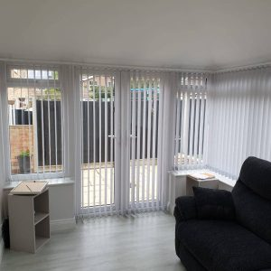 white vertical blinds on windows and doors