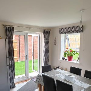 geometric black and white Roman blinds with matching curtains