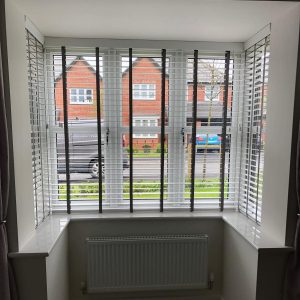 white Venetian blinds with tapes