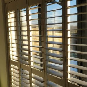 Plantation shutters close up tilted open