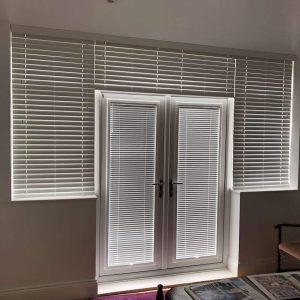 Venetian blinds on door and surrounding windows