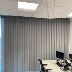 closed vertical blinds in office