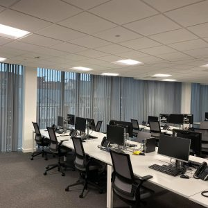 grey vertical blinds in commercial setting