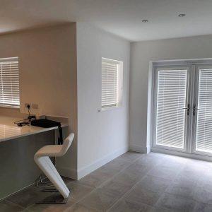 white Venetian blinds in ultra modern kitchen