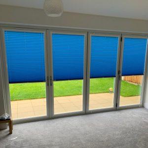 bright blue bi-fold door blinds