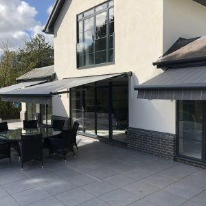 grey striped awning on modern house