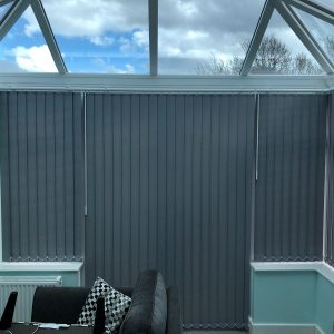 grey blinds in a conservatory with blue walls