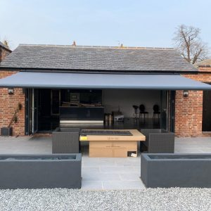 open grey awning on barn house