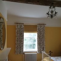 yellow Roman blinds in bedroom
