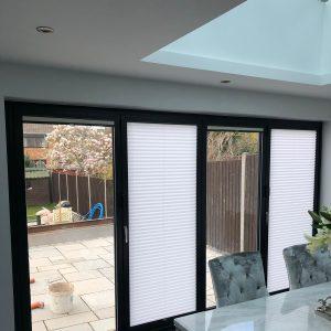 bifold door blinds, one open, one closed