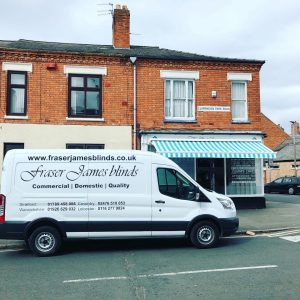 commercial awning over bakery shop front with Fraser James Blinds van