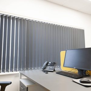grey vertical blinds in an office