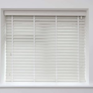 closeup of white faux wood Venetian blinds