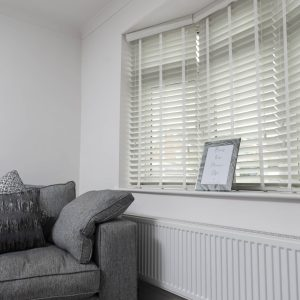 white faux wood blinds in modern lounge