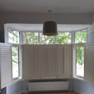 partly shut cafe style shutters