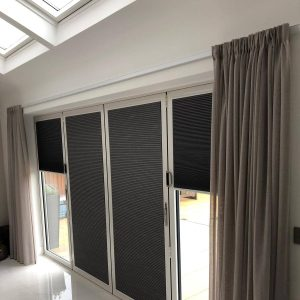 grey pleated blinds on bifold doors