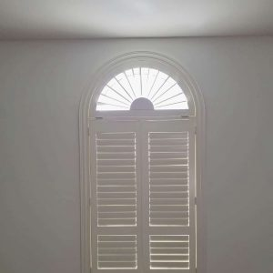 bespoke tier-on-tier shutters with curved top