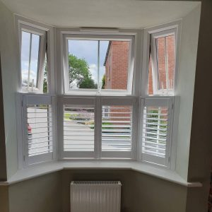 small open cafe style shutters on small bay window