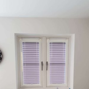 small pale purple pleated blinds in kitchen