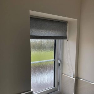 grey roller blind in bathroom