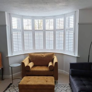 white shutters in stylish home