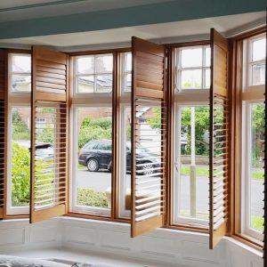 open wooden shutters on a bay window