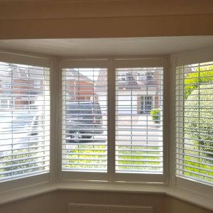white wooden shutters