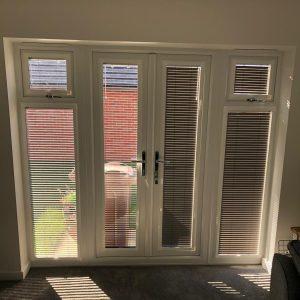 thin Venetian blinds on patio doors