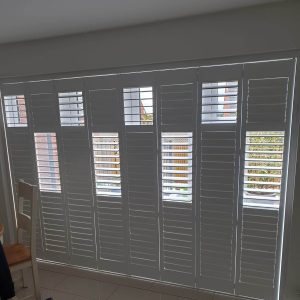 white partly closed full height shutters
