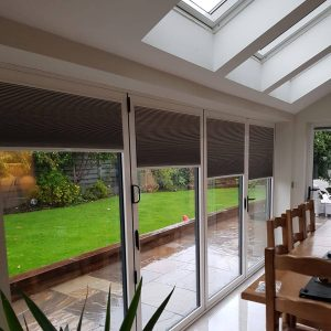 grey bi-fold door blinds