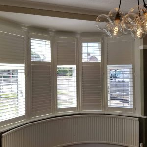 white plantation shutters, half opened, half closed