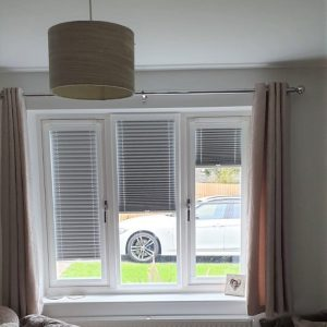 pleated blinds in neutral living room