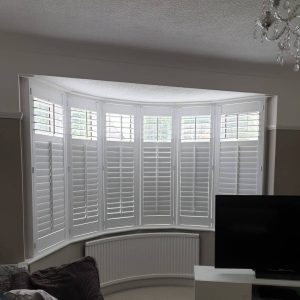 white plantation shutters on a large bay window