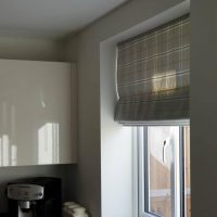 checked Roman blinds in a kitchen