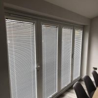 Venetian blinds on bi-fold doors