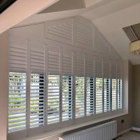 unusual shape window with bespoke shutters