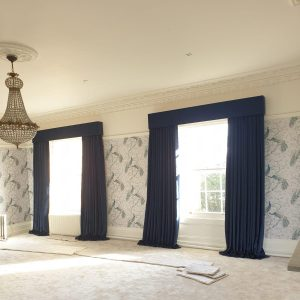 full length navy blue curtains in bedroom
